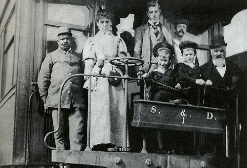 Porter with passengers on Canadian Pacific Transcontinental in the 1890�s � Courtesy of Canadian National Railway
