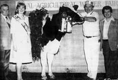1980 Royal Winter Fair.  From left to right: Maurice Jebson (Royal Holstein Judge), Ontario Dairy Princess Mary Bradfield; Bertram Stewart; and Frank Tedesco.