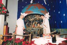 Nativity scene at St. Angela Merici Church with Fr. Lino Santi and Fr. Giovanni Bizzotto, 1985.  Courtesy of St. Angela Merici Church, P10545